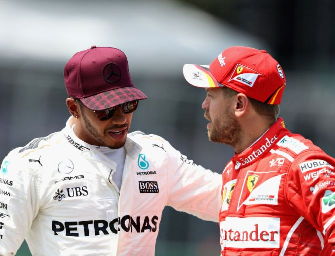 Lewis Hamilton, left, with Sebastian Vettel.