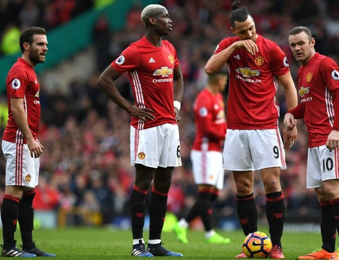 Manchester United's Juan Mata, left, Paul Pogba, Zlatan Ibrahimovic and Wayne Rooney all look on as they decide who will take a freekick during the Premier League match against AFC Bournemouth