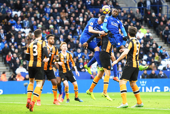 Hull City's Tom Huddlestone (centre) deflects Leicester City's Wilfred Ndidi's (right) header into his own net for the latter's third goal