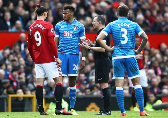 Bournemouth'S Tyrone Mings and Manchester United'S Zlatan Ibrahimovic clash