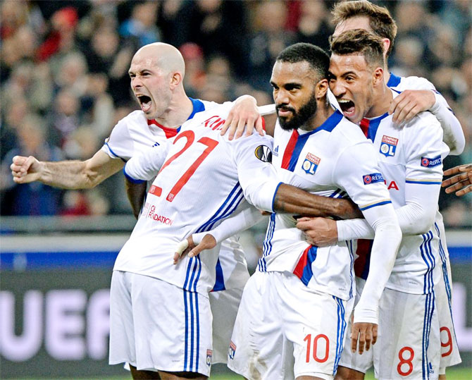 Olympic Lyon players celebrate a goal against AS Roma on Thursday