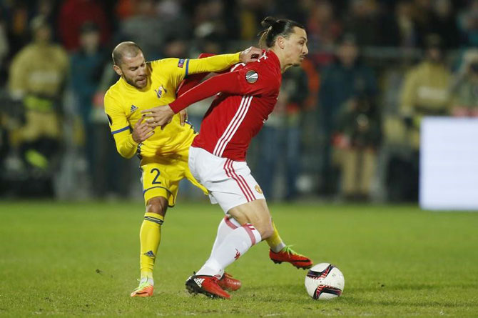 FC Rostov's Timofei Kalachev in action with Manchester United's Zlatan Ibrahimovic during their Europa League Round of 16 first leg match on Thursday