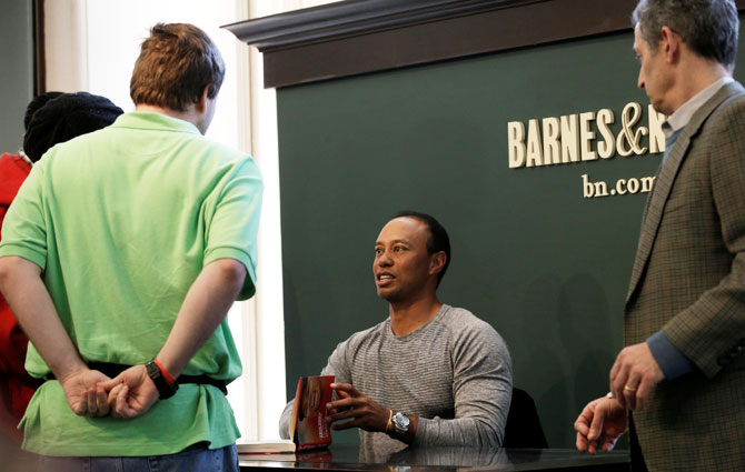 Golfer Tiger Woods signs copies of his new book The 1997 Masters: My Story' at a book signing event at a Barnes & Noble store in New York City, New York, US, on Monday, March 20