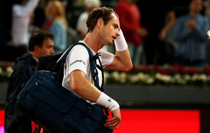 Andy Murray walks off the court after his loss against Borna Coric in the third round of the Madrid Open on Thursday
