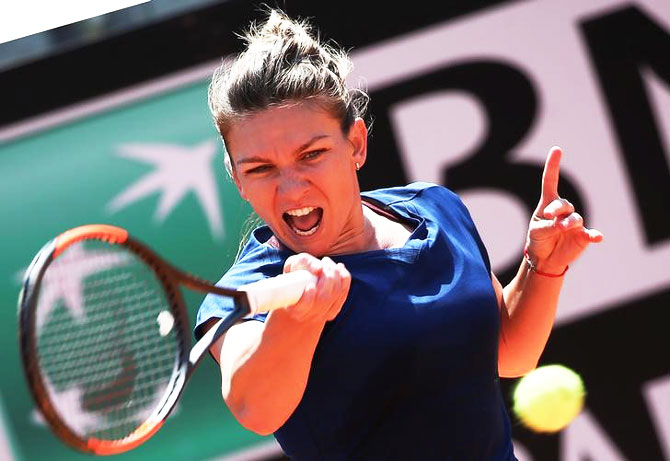 Romania's Simona Halep returns the ball during her match against Estonia's Anett Kontaveit