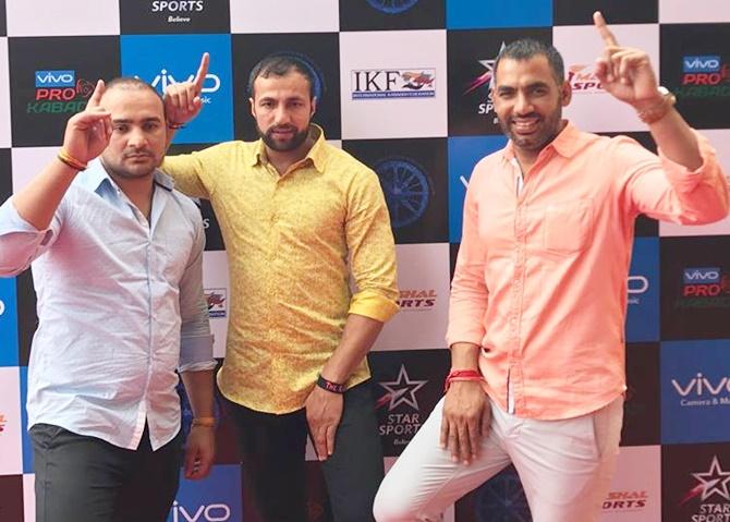 From left, Manjeet Chhillar, Rakesh Kumar, Anup Kumar at the PKL Auction