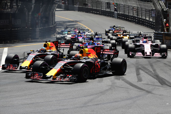 Daniel Ricciardo of Australia driving the (3) Red Bull Racing Red Bull-TAG Heuer RB13 TAG Heuer and Max Verstappen of the Netherlands driving the (33) Red Bull Racing Red Bull-TAG Heuer RB13 TAG Heuer battle for position at the start of the race
