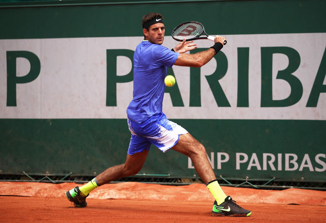 Argentina's Juan Martin Del Potro plays a backhand shot during his first round match against compatriot Guido Pella