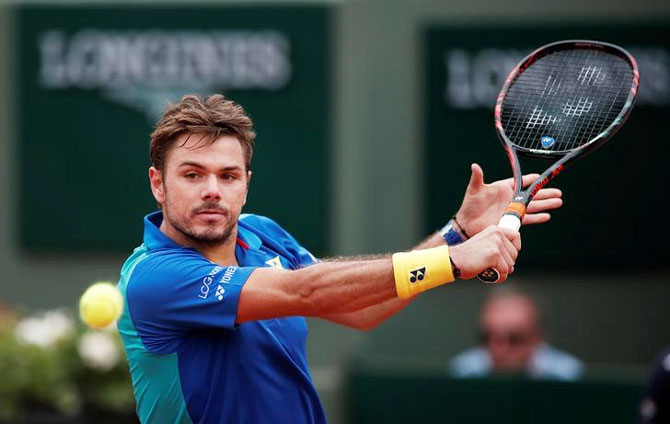 Switzerland's Stan Wawrinka in action during his first round match against Slovakia's Jozef Kovalik