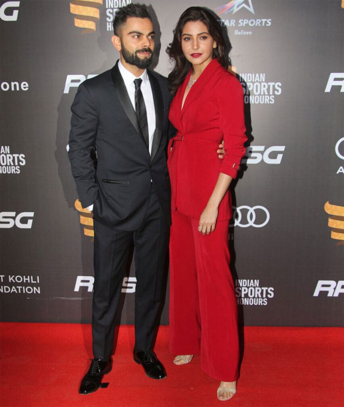 India's cricket captain Virat Kohli and girlfriend make a smoking entry at the red carpet of the Indian Sports Honours on Saturday