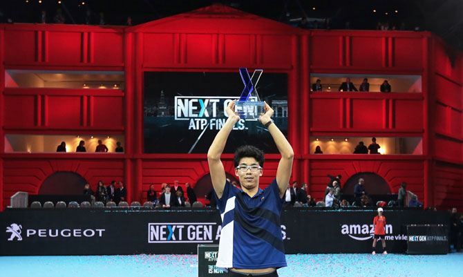 South Korea's Hyeon Chung celebrates with the trophy after victory against Russia's Andrey Rublev in the men's final of the Next Gen ATP Finals in Milan, Italy, on Saturday