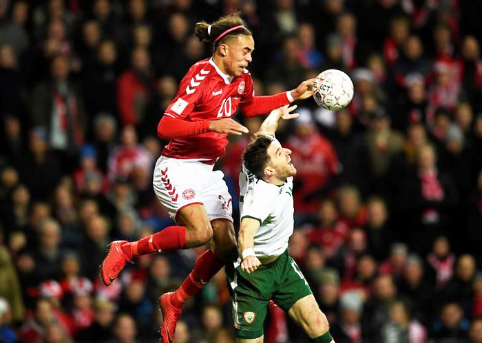 Denmark's Yussuf Yurary Poulsen and Ireland's Stephen Ward in an aerial duel as they vie for possession at Telia Parken in Copenhagen in Denmark on Saturday