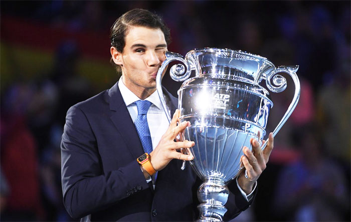 Spain's Rafael Nadal kisses the Emirates ATP year end World Number One trophy after a presentation on the first day of the Nitto ATP World Tour Finals at O2 Arena on Sunday