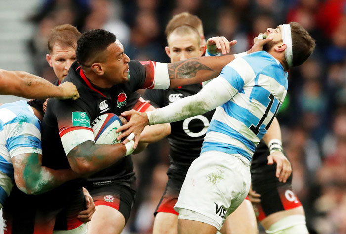 England's Nathan Hughes and with Argentina's Ramiro Moyano Joya in action during their autumn series Rugby Union match in England on Saturday