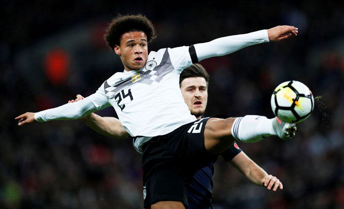 Germany's Leroy Sane in action with England's Harry Maguire during their international friendly on Friday