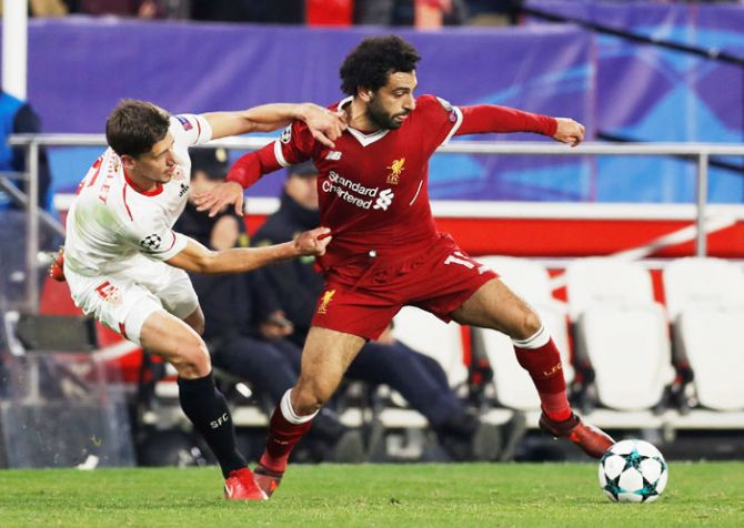 Liverpool's Mohamed Salah is challenged by Sevilla's Clement Lenglet