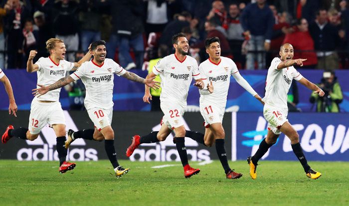 Sevilla's Guido Pizarro celebrates scoring their third goal with teammates Ever Banega, Franco Vazquez, Joaquin Correa during their match against Liverpool at the Ramon Sanchez Pizjuan in Seville.