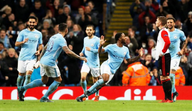 Manchester City's Raheem Sterling celebrates scoring their first goal with teammates