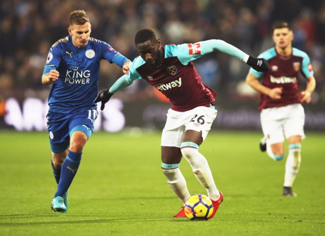 West Ham United's Arthur Masuaku holds off Leicester City's Marc Albrighton during their English Premier League match at London Stadium in London on Friday
