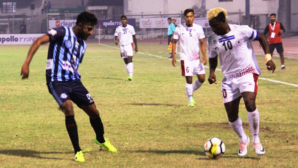 Players from Minerva Punjab and Mohun Bagan vie for possession