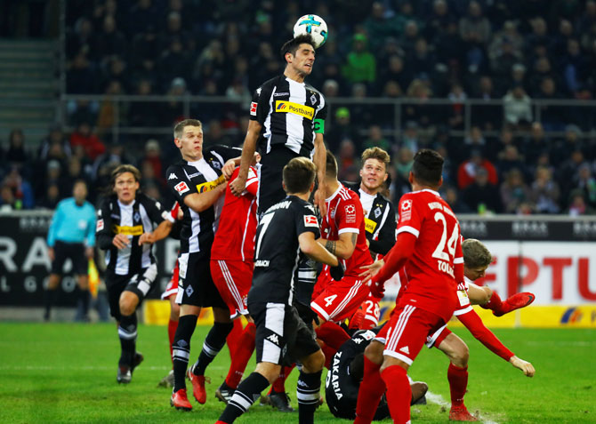 Borussia Monchengladbach's Lars Stindl and Bayern players vie for possession