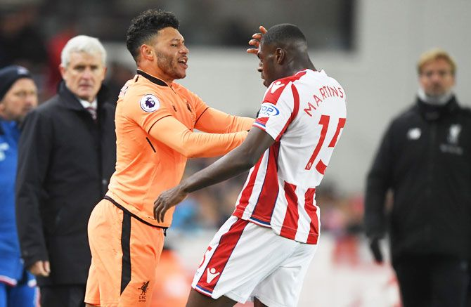 Liverpool's Alex Oxlade-Chamberlain and Stoke City's Bruno Martins Indi get into a scuffle
