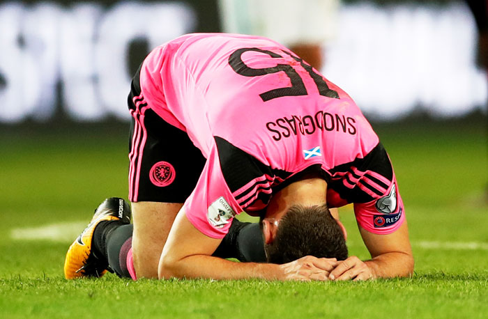 Scotland's Robert Snodgrass looks dejected after the match against Slovenia