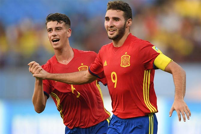 Spain captain Abel Ruiz, right, celebrates after scoring a goal.