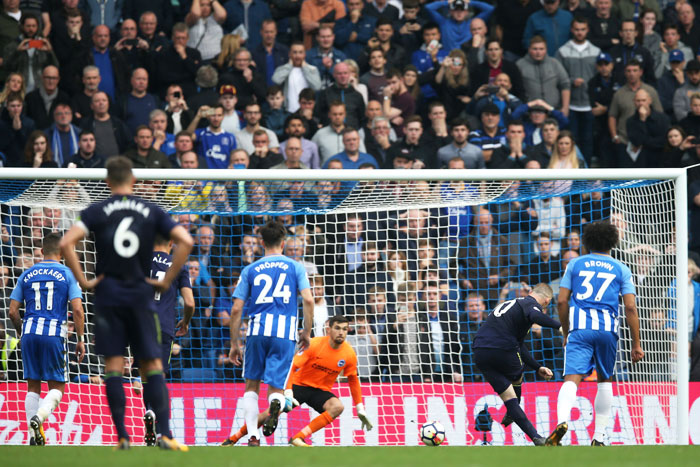 Everton's Wayne Rooney scores from the penalty spot during their Premier League match against Brighton and Hove Albion at Amex Stadium in Brighton, England, on Sunday