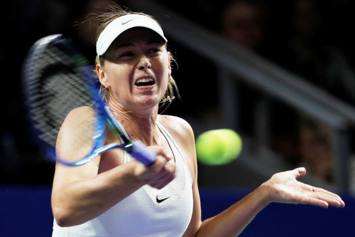 Russia's Maria Sharapova in action against Slovakia's Magdalena Rybarikova during the first round match of the Kremlin Cup in Moscow, Russia on Tuesday
