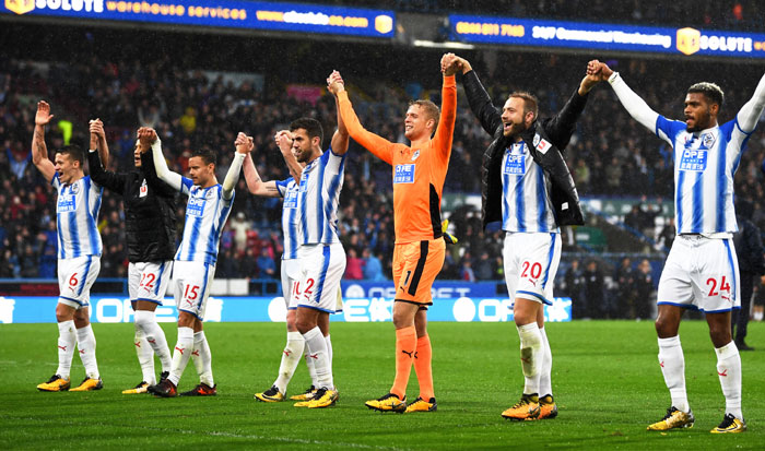 Huddersfield Town players celebrate after comprehensively beating Manchester United