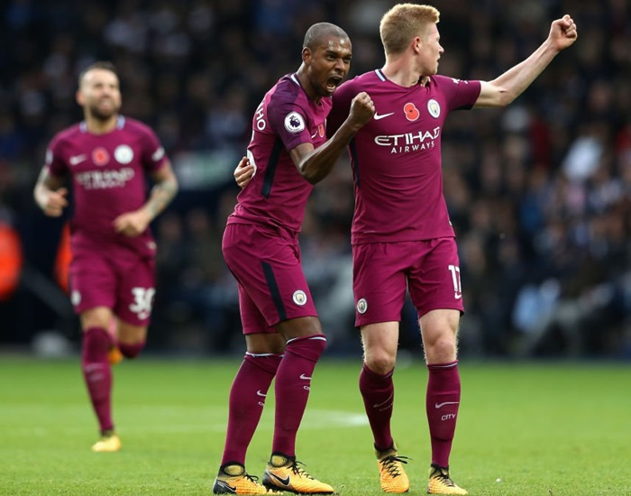 EPL PIX: Man City surge on, United sink Spurs to stay second
