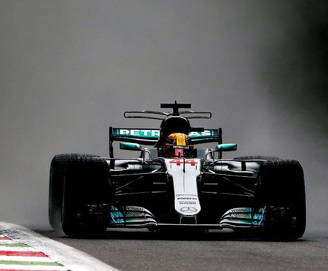 Hamilton beats rain to break Schumacher's pole record