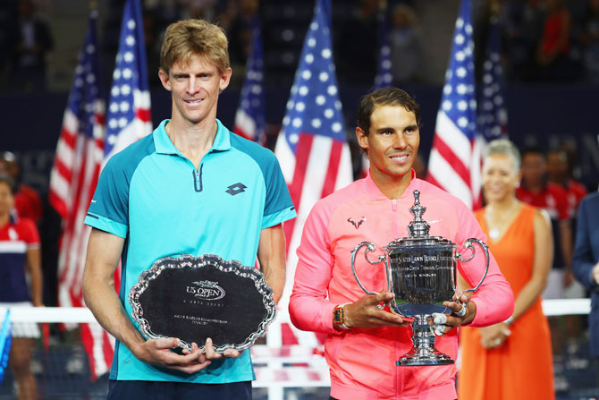 US Open finalist South Africa's Kevin Anderson and US Open winner Spain's Rafael Nadal pose during the trophy ceremony after their final match on Sunday. It was just the seventh time since tennis went professional in 1968 that a men's grand slam final was contested by two players 30 and over