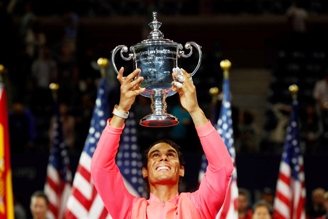 Rafael Nadal holds the trophy aloft after winning the US Open in New York on Sunday