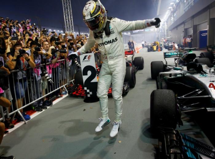 Singapore GP: Hamilton wins after Vettel crashes out