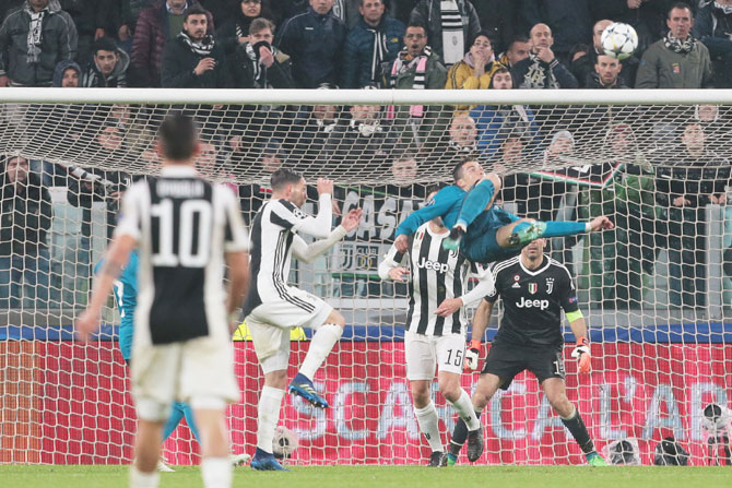 Real Madrid's Cristiano Ronaldo scores an acrobatic second goal against Juventus in during the UEFA Champions League quarter-final first leg match at Allianz Stadium in Turin on Tuesday
