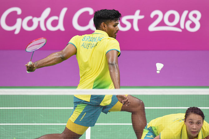 Australia's Sawan Serasinghe (left) and his mixed doubles partner Setyana Mapasa compete during the badminton mixed team group stage match against England at Carrara Sports and Leisure Centre