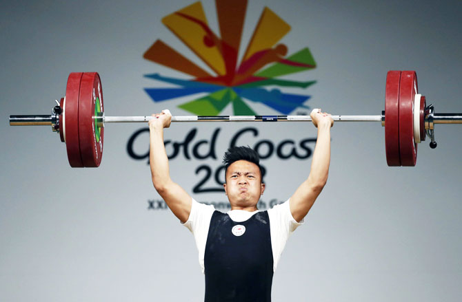 Singapore's En Wei John Cheah in action during the men's 85kg weightlifting final at Carrara Sports Arena 1