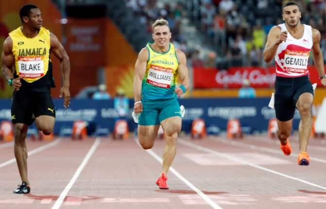 With best wishes from Bolt, Blake qualifies fastest for 100 final