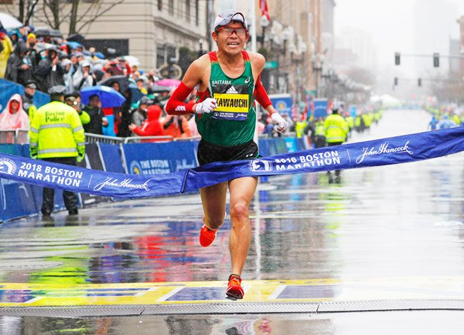 Japan's Yuki Kawauchi crosses the finish line to win the men's division of the 122nd Boston Marathon