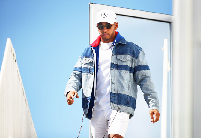 Mercedes GP's British driver Lewis Hamilton walks in the Paddock during previews ahead of the Azerbaijan Formula One Grand Prix at Baku City Circuit in Baku, Azerbaijan, on Thursday