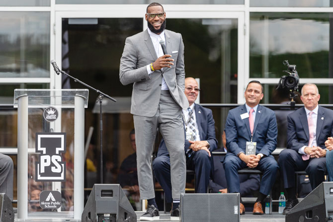 LeBron James addresses the crowd during the opening ceremonies of the I Promise School in Akron, Ohio, on Monday
