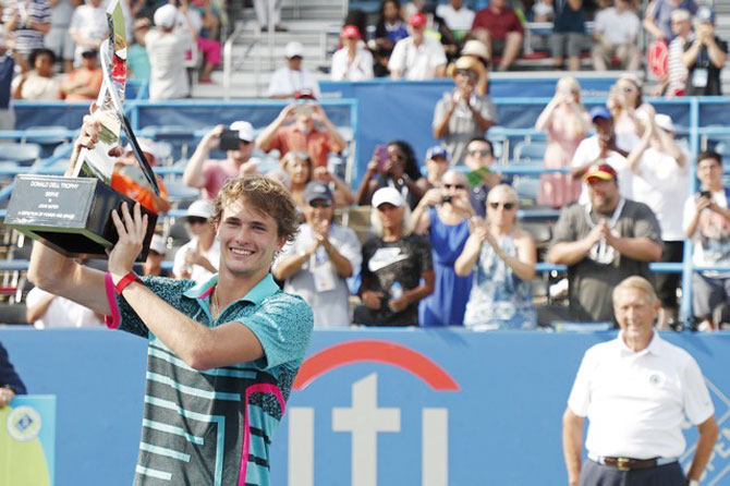 Germany's Alexander Zverev holds the Donald Dell Trophy after he beat Australia's Alex de Minaur to win the Citi Open final at Rock Creek Park Tennis Center in Washington on Sunday