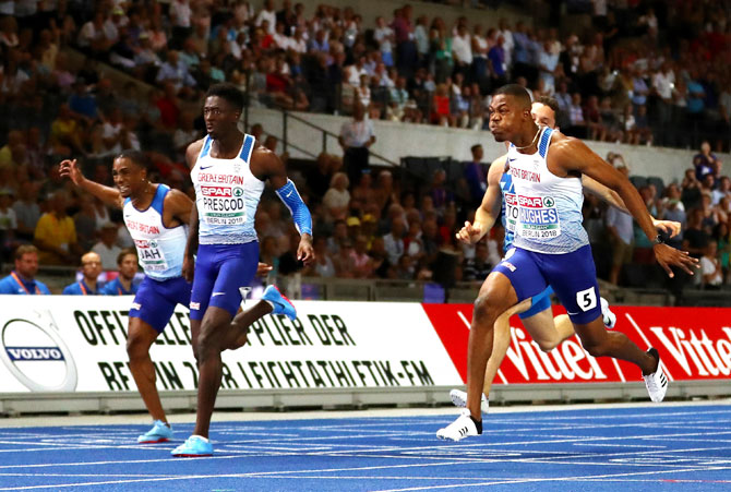 Great Britain'S Zharnel Hughes crosses the line to win the Gold medal as compatriot Reece Prescod crosses to win the Silver medal in the Men's 100 metres final on Day one of the 24th European Athletics Championships at Olympiastadion in Berlin on Tuesday