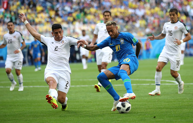 Brazil's Neymar wins the ball in a challenge with Costa Rica's Jonny Acosta during the 2018 FIFA World Cup Russia Group E match at Saint Petersburg Stadium on June 22, 2018