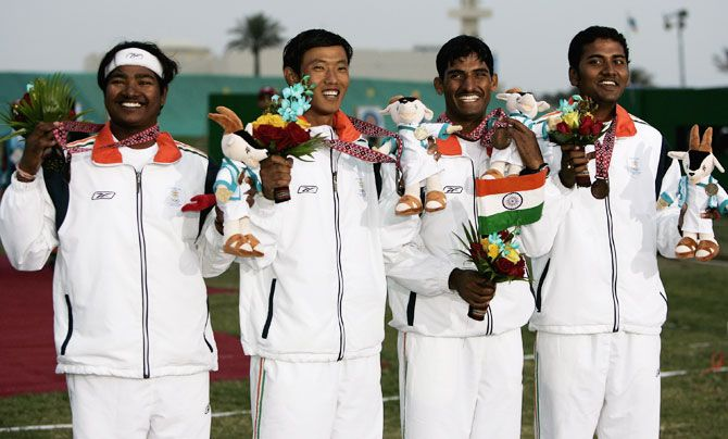(From left to right) India's Mangal Singh Champia, Tarundeep Rai, Jayanta Talukda and Viswash with their bronze medals during the ceremony after the Men's team Archery event at the 2006 Asian Games in Doha at the Lusail Archery Range on in Doha, Qatar
