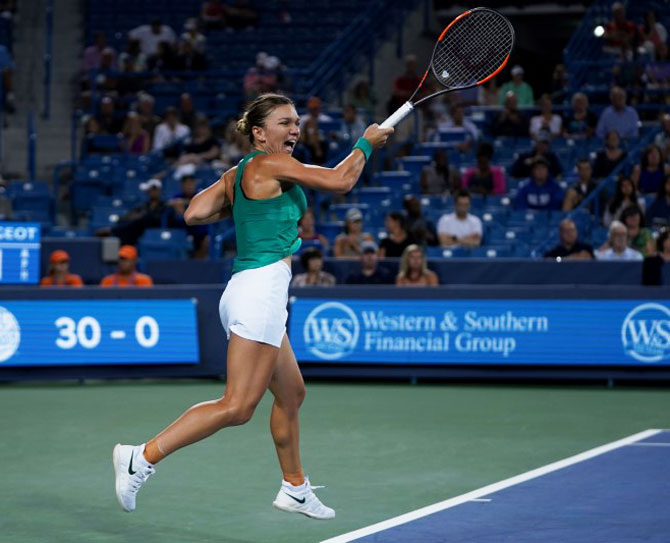 Simona Halep returns a shot against Ajla Tomljanovic in the Western and Southern tennis open at Lindner Family Tennis Center in Mason, Ohio, on Thursday