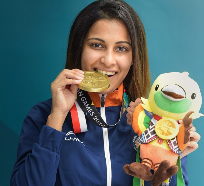 Heena Sidhu shows off her bronze medal on the podium at the Asian Games on Friday
