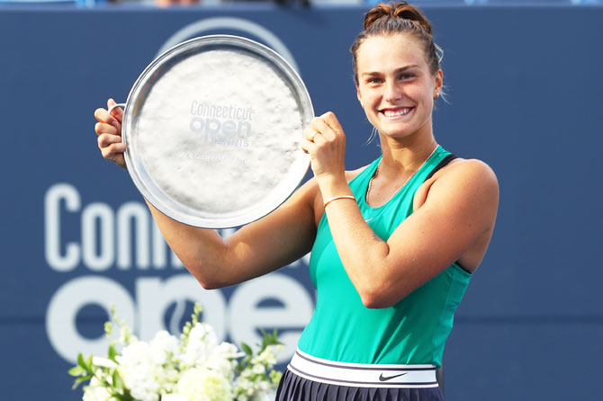 Belarus' Aryna Sabalenka celebrates with her trophy after defeating Spain's Carla suarez Navarro in the Connecticut Open final at Connecticut Tennis Center at Yale in New Haven, Connecticut, on Saturday